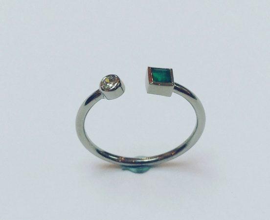 18ct. White gold, diamond & emerald engagement ring