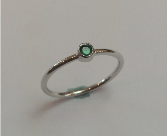 18ct. White gold & emerald engagement ring