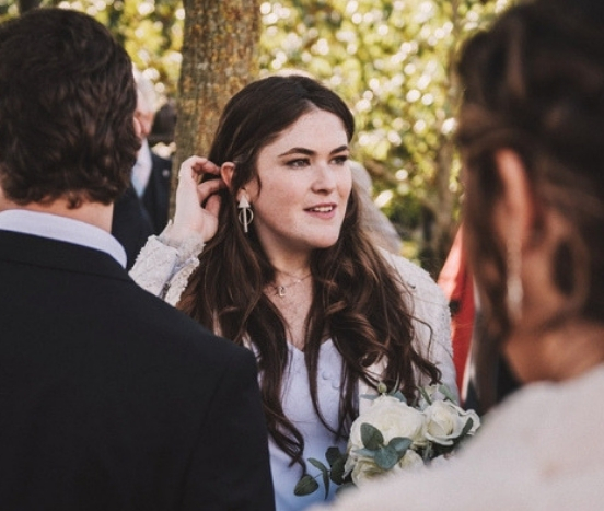 THE BRIDE WEARING A BESPOKE EARRINGS AT THE WEDDING